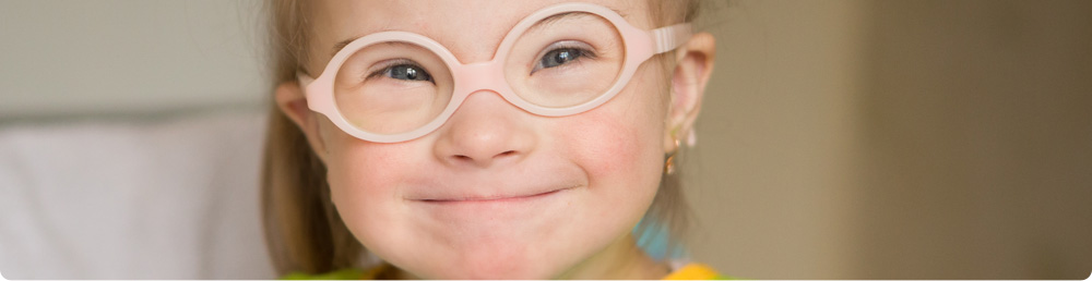 A young child wearing fake plastic glasses.
